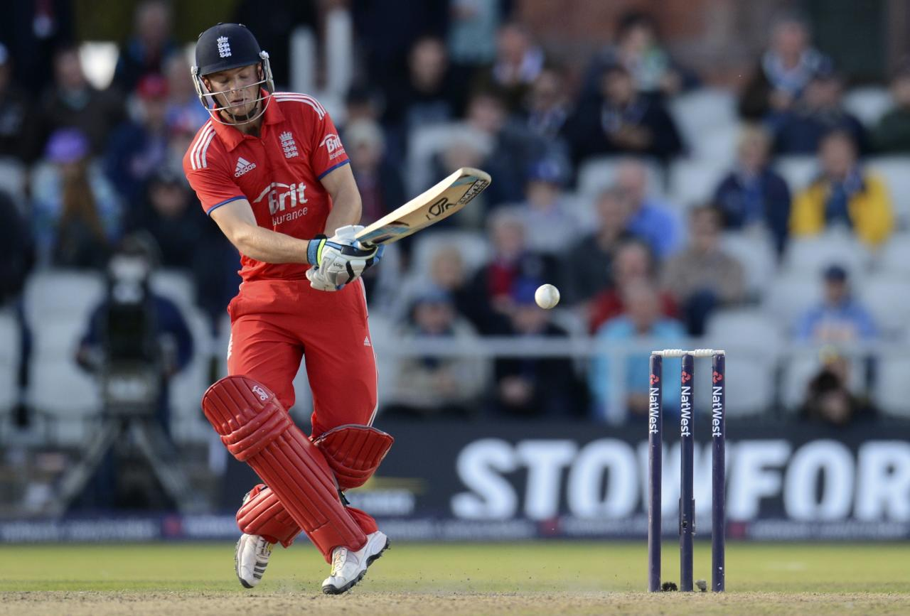 England's Jos Buttler misses the ball during the second one-day international against Australia at Old Trafford cricket ground in Manchester September 8, 2013. REUTERS/Philip Brown (BRITAIN - Tags: SPORT CRICKET)