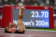 Katarina Johnson-Thompson, of Britain, reacts after falling during a heat in the heptathlon women's 200-meter at the 2020 Summer Olympics, Wednesday, Aug. 4, 2021, in Tokyo. (AP Photo/Martin Meissner)