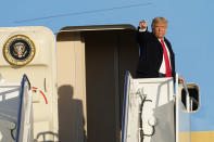 President Donald Trump gestures from the top of the steps of Air Force One at Andrews Air Force Base, Md., Wednesday, Oct. 21, 2020. Trump is heading to North Carolina for a campaign rally. (AP Photo/Susan Walsh)