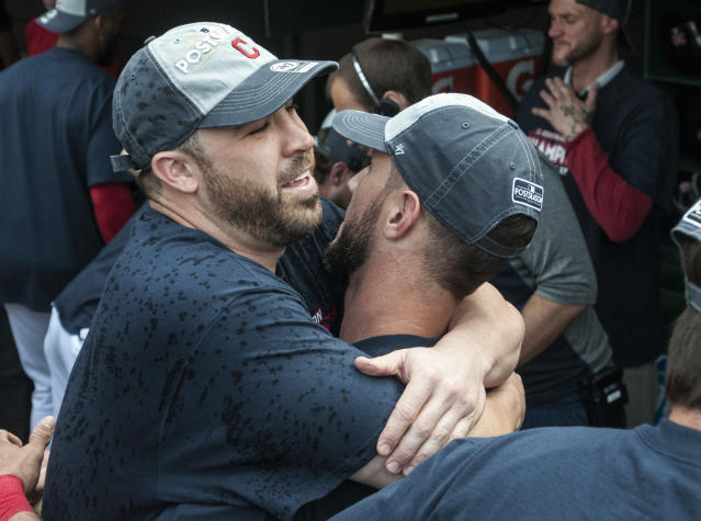 Cleveland Indians' Jason Kipnis left, and Yan Gomes celebrate after winning the American League Central Division Championship and defeating the Kansas City Royals in a baseball game in Cleveland, Sunday, Sept. 17, 2017. (AP Photo/Phil Long)