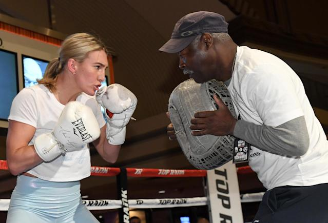 Boxer Mikaela Mayer (L) works out with her coach ahead of her super featherweight bout vs. Lizbeth Crespo (not pictured) on June 15 at MGM Grand Garden Arena in Las Vegas. (Getty Images)