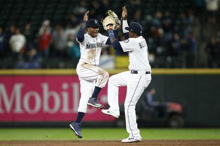 Apr 1, 2019; Seattle, WA, USA; Seattle Mariners center fielder Mallex Smith (left) celebrates with shortstop Tim Beckham (right) after defeating the Los Angeles Angels at T-Mobile Park. Mandatory Credit: Jennifer Buchanan-USA TODAY Sports