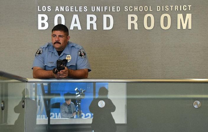 A security guard stands at the administrative offices of the Los Angeles Unified School District on December 15, 2015 (AFP Photo/Frederic J. Brown)