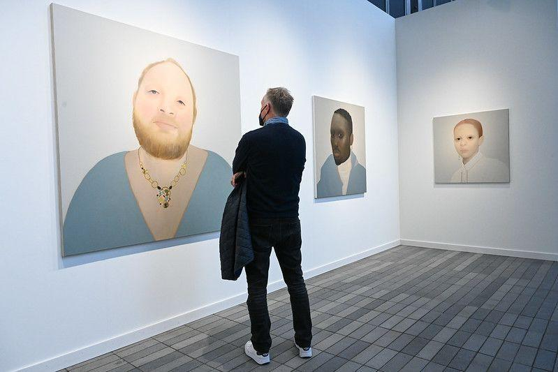 """<p>We were taken by the luminous, large-scale portraiture of the Yorkshire, England–born painter Sarah Ball. The artist selects her subjects through found images from newspapers, magazines, and social media, but unlike Richard Prince and his famously <a href=""""http://vulture.com/2014/09/richard-prince-instagram-pervert-troll-genius.html"""" rel=""""nofollow noopener"""" target=""""_blank"""" data-ylk=""""slk:troll-y Instagram paintings"""" class=""""link rapid-noclick-resp"""">troll-y Instagram paintings</a>, Ball approaches her subjects with a tender intimacy. Large swaths of her images (namely backdrops and clothing) are rendered nearly flat in favor of evocative details like a stud earring, a necklace, and—most of all—the anonymous sitters' eyes. </p>"""