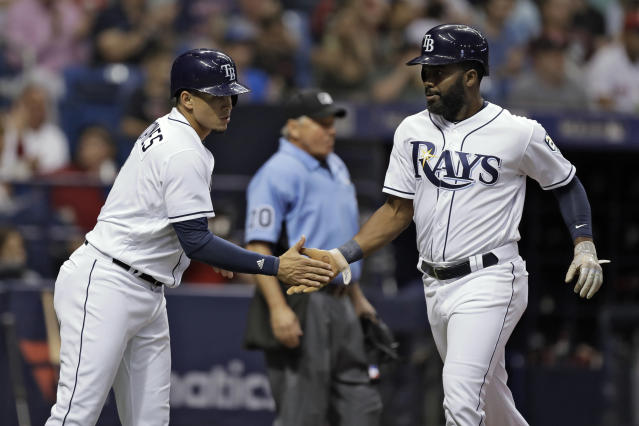 Tampa Bay Rays' Willy Adames, left, and Denard Span celebrate after scoring on a two-run single by Wilson Ramos off Boston Red Sox starting pitcher Rick Porcello during the second inning of a baseball game Thursday, May 24, 2018, in St. Petersburg, Fla. (AP Photo/Chris O'Meara)