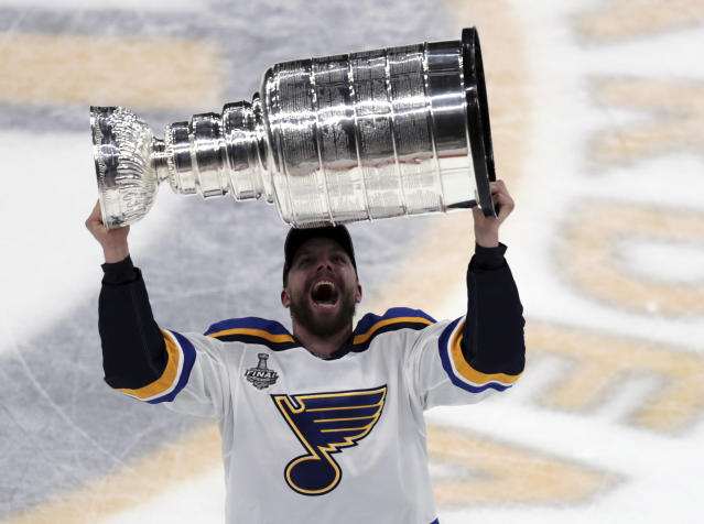 St. Louis Blues' David Perron carries the Stanley Cup after the Blues defeated the Boston Bruins in Game 7 of the NHL Stanley Cup Final, Wednesday, June 12, 2019, in Boston. (AP Photo/Charles Krupa)