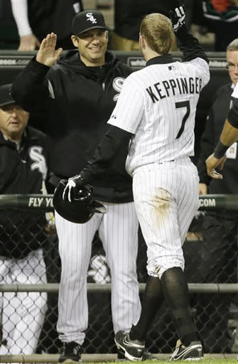 Chicago White Sox's Jeff Keppinger (7) celebrates with manager Robin Ventura after hitting a game-winning single against the Miami Marlins during the 11th inning of a baseball game on Friday, May 24, 2013, in Chicago. The White Sox won 4-3. (AP Photo/Nam Y. Huh)