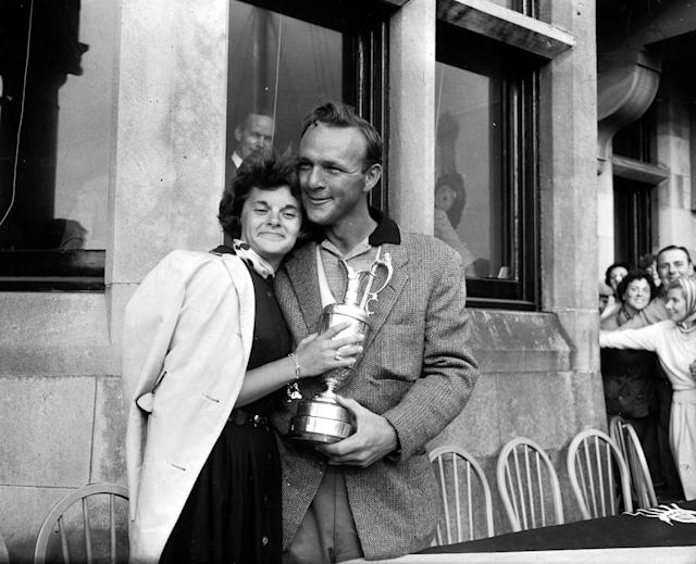 <p>Arnold Palmer is pictured with his wife Winnie, holding the Claret Jug after his victory, surrounded by well-wishers, Palmer won the tournament with a four round aggregate of 276 shots (Photo by Bob Thomas/Getty Images) </p>