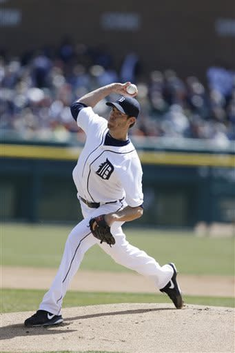 Detroit Tigers starting pitcher Doug Fister throws during the first inning of a baseball game against the New York Yankees in Detroit, Friday, April 5, 2013. (AP Photo/Carlos Osorio)