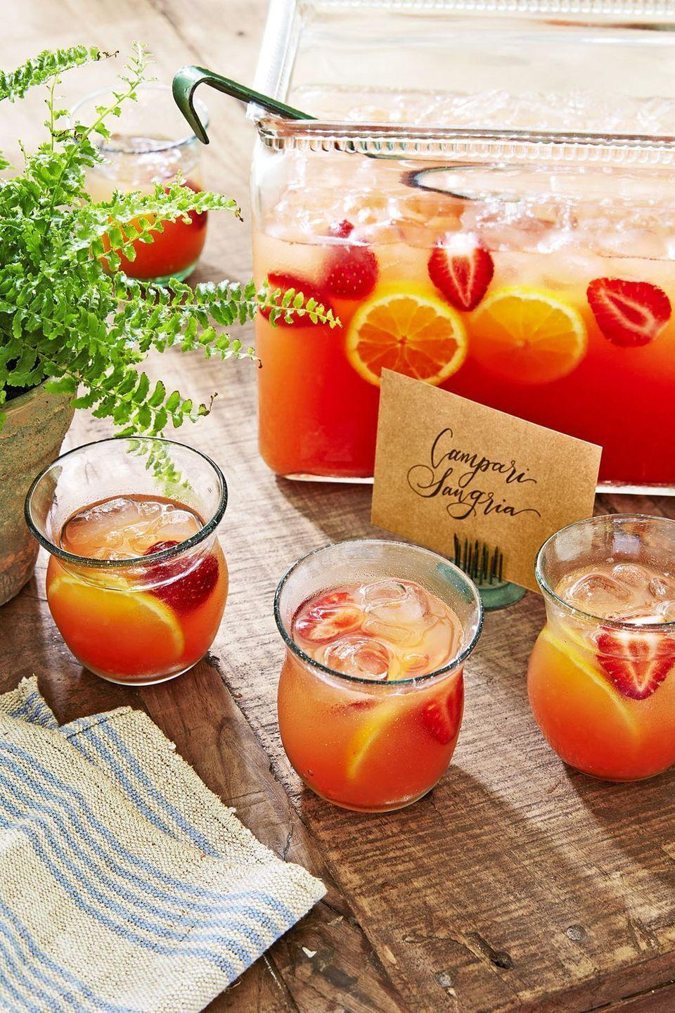 """<p>The fruity yet bitter liqueur adds interest (and bright color!) to this simple rosé sangria.</p><p><em><a href=""""https://www.countryliving.com/food-drinks/a22668011/campari-sangria-recipe/"""" rel=""""nofollow noopener"""" target=""""_blank"""" data-ylk=""""slk:Get the recipe from Country Living »"""" class=""""link rapid-noclick-resp"""">Get the recipe from Country Living »</a></em></p><p><strong>RELATED: </strong><a href=""""https://www.goodhousekeeping.com/food-recipes/easy/g3589/best-sangria-recipes/"""" rel=""""nofollow noopener"""" target=""""_blank"""" data-ylk=""""slk:24 Best Sangria Recipes to Sip All Summer Long"""" class=""""link rapid-noclick-resp"""">24 Best Sangria Recipes to Sip All Summer Long</a></p>"""