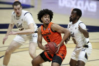 Oregon State guard Ethan Thompson, center, drives against California forward Makale Foreman, right, and forward Grant Anticevich during the first half of an NCAA college basketball game in Berkeley, Calif., Thursday, Feb. 25, 2021. (AP Photo/Jed Jacobsohn)