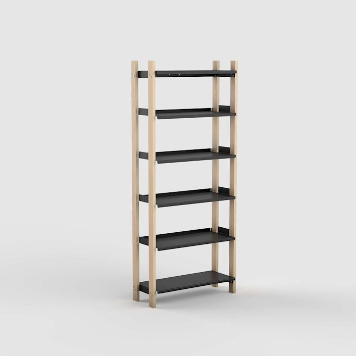 """A lot of eyeballs have been drawn to the formerly underappreciated <a href=""""https://www.architecturaldigest.com/gallery/12-clever-approved-bookshelves-that-wont-blow-your-budget?mbid=synd_yahoo_rss"""" rel=""""nofollow noopener"""" target=""""_blank"""" data-ylk=""""slk:bookshelf"""" class=""""link rapid-noclick-resp"""">bookshelf</a> this year thanks to Zoom calls and, for some, lots of time to catch up on <a href=""""https://www.architecturaldigest.com/gallery/must-have-coffee-table-books-to-give-and-receive-for-the-holidays?mbid=synd_yahoo_rss"""" rel=""""nofollow noopener"""" target=""""_blank"""" data-ylk=""""slk:reading"""" class=""""link rapid-noclick-resp"""">reading</a>. This Floyd shelving unit was of particular interest to our readers. Customizable in shape, size, color, and configuration, it's another product that can do more than its traditional counterparts. Floyd's <a href=""""https://floydhome.com/products/the-floyd-platform-bed?color=Walnut+%2F+Black&headboard=none&bedSize=full-queen"""" rel=""""nofollow noopener"""" target=""""_blank"""" data-ylk=""""slk:platform bed"""" class=""""link rapid-noclick-resp"""">platform bed</a>, similarly constructed of clean lines with minimal hardware, was also a top contender in your carts this year. $685, Floyd. <a href=""""https://floydhome.com/products/the-floyd-shelving-system?color=Black+%2F+Ash&shelvingSystems=tall"""" rel=""""nofollow noopener"""" target=""""_blank"""" data-ylk=""""slk:Get it now!"""" class=""""link rapid-noclick-resp"""">Get it now!</a>"""