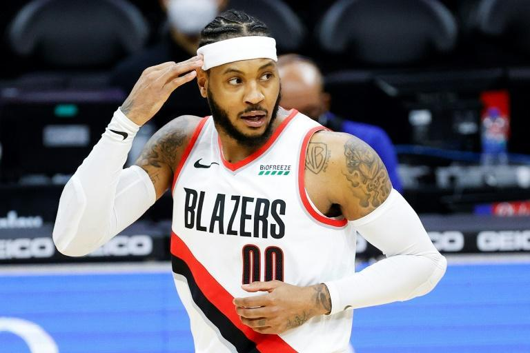 Portland veteran Carmelo Anthony motions after hitting one of his three, three pointers as the under-manned Trail Blazers used their reserve lineup to upset the mighty Philadelphia 76ers 121-105