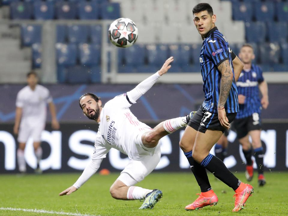 <p>Isco fights for the ball with Cristian Romero</p> (AP)
