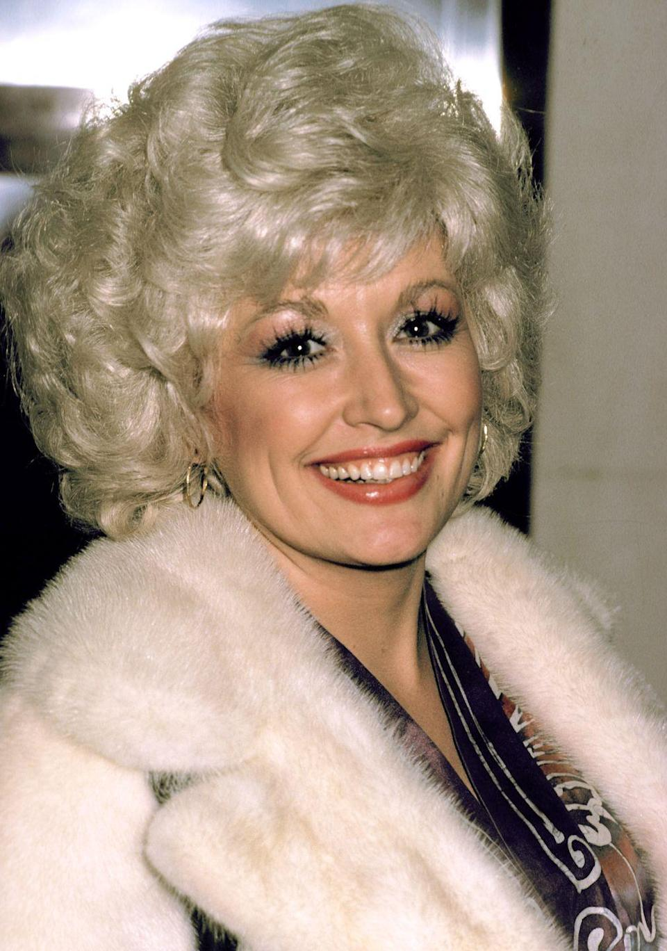 <p> Dolly looks cozy and chic in a fur coat at a premiere in Edinburgh, Scotland. The singer is most-always found in voluptuous makeup and hoop earrings.</p>