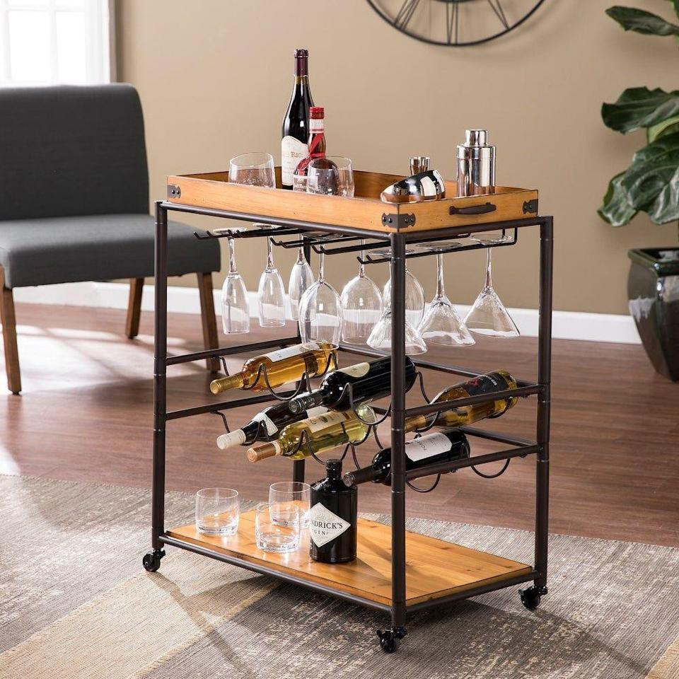 """<p><strong>Copper Grove</strong></p><p>overstock.com</p><p><strong>$110.49</strong></p><p><a href=""""https://go.redirectingat.com?id=74968X1596630&url=https%3A%2F%2Fwww.overstock.com%2FHome-Garden%2FCopper-Grove-Maya-Modern-Farmhouse-Black-Wood-Bar-Cart%2F28899556%2Fproduct.html&sref=https%3A%2F%2Fwww.housebeautiful.com%2Fshopping%2Fg35941019%2Foverstock-red-tag-sale%2F"""" rel=""""nofollow noopener"""" target=""""_blank"""" data-ylk=""""slk:Shop Now"""" class=""""link rapid-noclick-resp"""">Shop Now</a></p><p>This all-in-one bar cart offers great wine storage and looks good too!</p>"""
