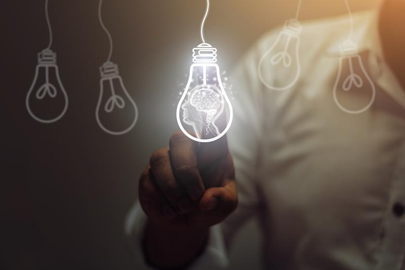 Businessman touching light bulbs. ideas of new ideas with innovative technology and creativity.