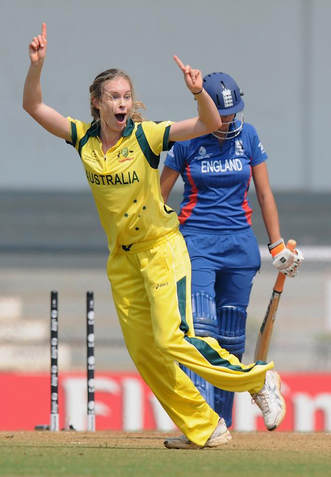 MUMBAI, INDIA - FEBRUARY 08:  Holly Ferling of Australia celebrates the wicket Jennifer Gunn of England  a wicket during the super six match  between England and Australia held at the CCI (Cricket Club of India)  on February 8, 2013 in Mumbai, India.  (Photo by Pal Pillai/Getty Images)