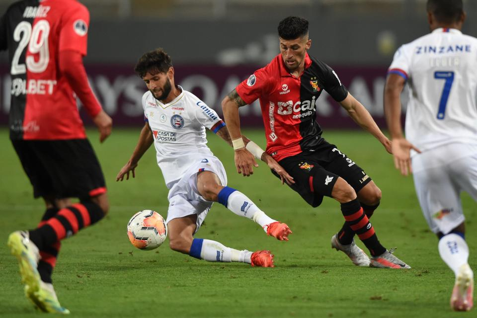 Brazil's Bahia player Juninho Capixaba (R) and Peru's Melgar player, Argentine Emanuel Amoroso vie for the ball during their closed-door Copa Sudamericana second round football match at the National Stadium in Lima, on October 29, 2020, amid the COVID-19 novel coronavirus pandemic. (Photo by ERNESTO BENAVIDES / AFP) (Photo by ERNESTO BENAVIDES/AFP via Getty Images)