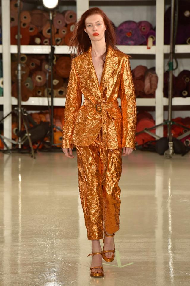<p>Model wears an orange metallic pantsuit at the fall 2018 Sies Marjan show. (Photo: Getty Images) </p>