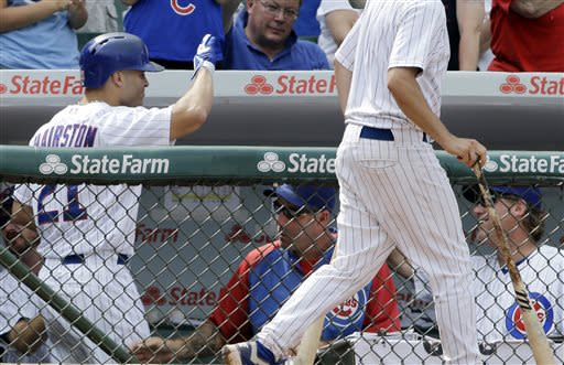 Chicago Cubs' Scott Hairston, left, celebrates with teammates in the dugout after hitting a solo home run during the seventh inning of a baseball game against the Pittsburgh Pirates in Chicago, Sunday, July 7, 2013. (AP Photo/Nam Y. Huh)