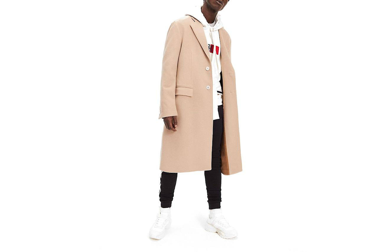 """This coat—from F1 legend Lewis Hamilton's new collection with Tommy Hilfiger—might not make you drive faster. But it certainly can't hurt. —Sam Schube $550, Tommy Hilfiger. <a href=""""https://usa.tommy.com/en/men/tommy-x-lewis/lewis-hamilton-virgin-wool-overcoat-mw11479"""">Get it now!</a>"""