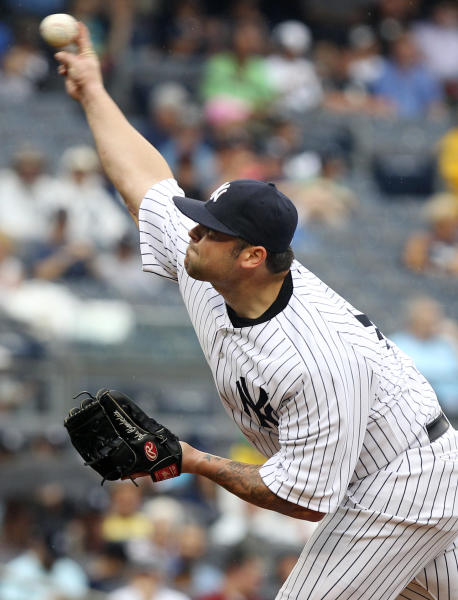 New York Yankees' Joba Chamberlain pitches during the eighth inning of the baseball game against the Baltimore Orioles, Wednesday, Aug. 1, 2012, at Yankee Stadium in New York. (AP Photo/Seth Wenig)