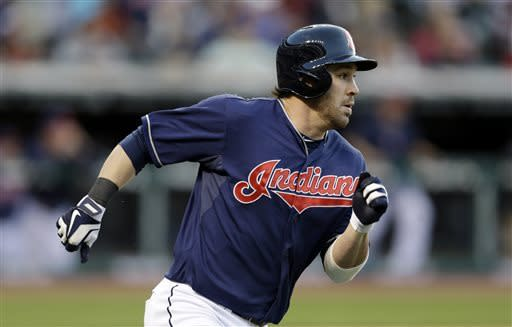 Cleveland Indians' Jason Kipnis runs the bases after hitting a two-run triple off Minnesota Twins starting pitcher Pedro Hernandez in the third inning of a baseball game, Friday, May 3, 2013, in Cleveland. Yan Gomes and Drew Stubbs scored. (AP Photo/Tony Dejak)