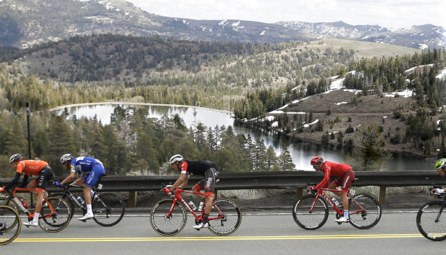 The peloton races down Highway 88 after crossing Carson Pass in the Central Sierra Nevada during the sixth stage of the Tour of California cycling race, near Kirkwood, Calif., Friday, May 18, 2018. (AP Photo/Rich Pedroncelli)