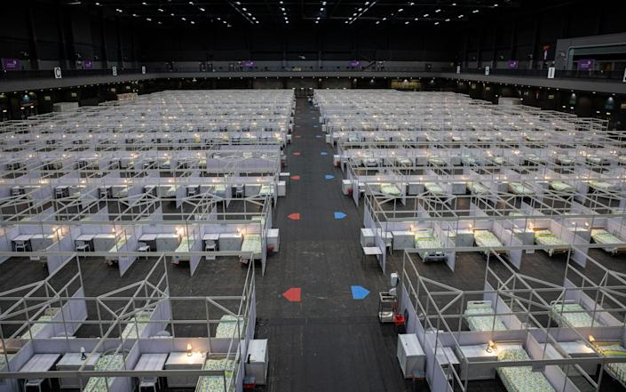 Beds are set up in a temporary facility at the AsiaWorld Expo in Hong Kong - JEROME FAVRE/EPA-EFE/Shutterstock