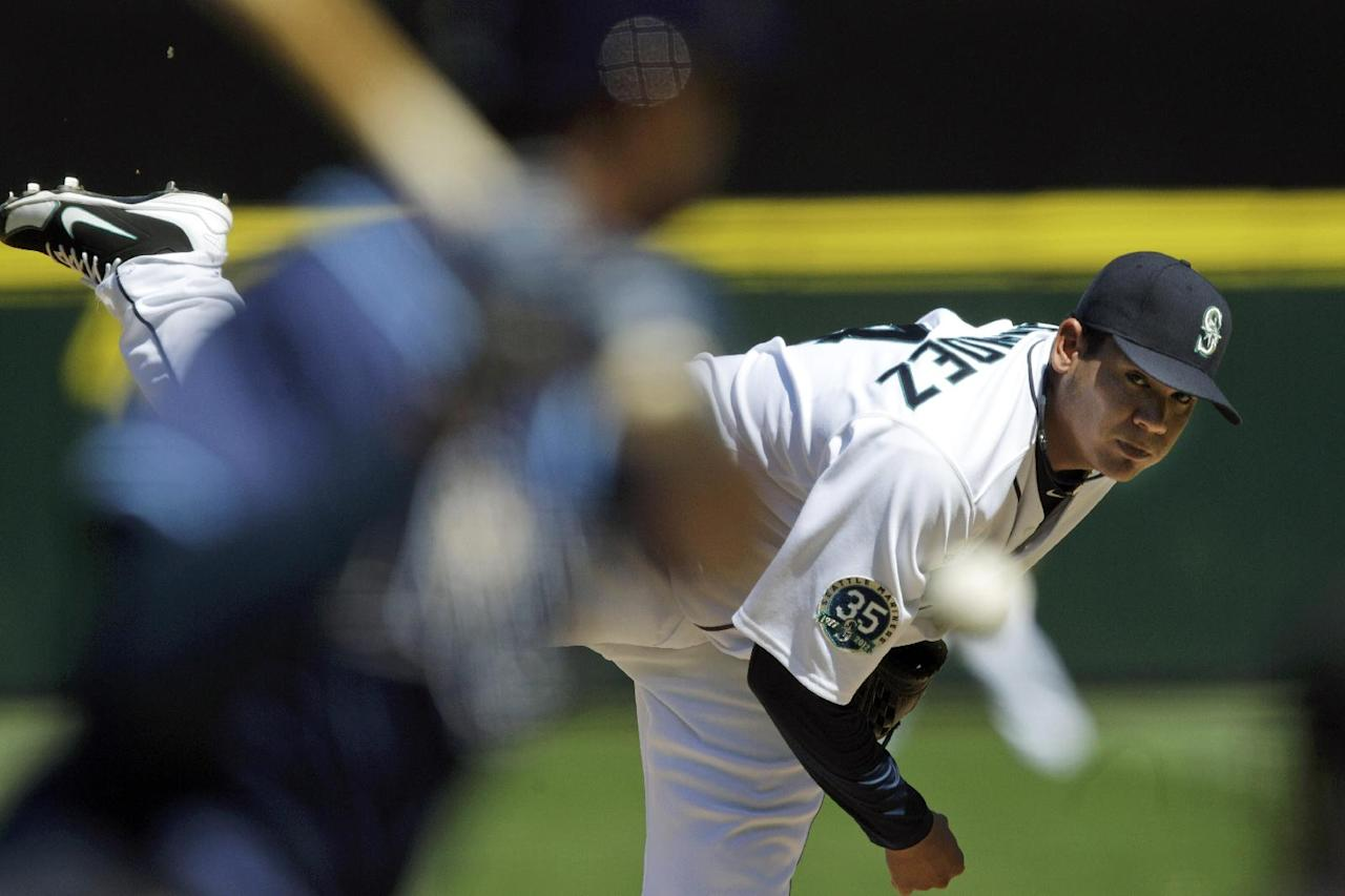 Seattle Mariners starting pitcher Felix Hernandez throws against the Tampa Bay Rays in the fourth inning of a baseball game, Wednesday, Aug. 15, 2012, in Seattle. Hernandez tossed a perfect game in the Mariners 1-0 win. (AP Photo/Ted S. Warren)