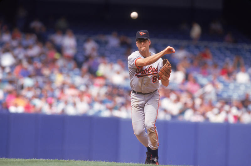BRONX, NY - 1992: Baltimore Orioles' shortstop Cal Ripken Jr. #8 throws to first duing a game against the New York Yankees at Yankee Stadium circa 1992 in Bronx, New York. (Photo by Focus on Sport via Getty Images)
