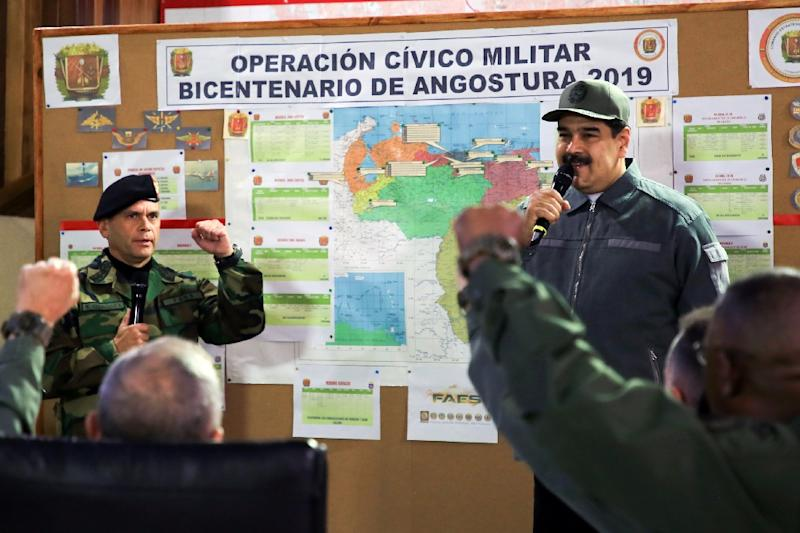In this handout image, President Nicolas Maduro checks in with military brass in Caracas January 15, 2019 (AFP Photo/Marcelo GARCIA)