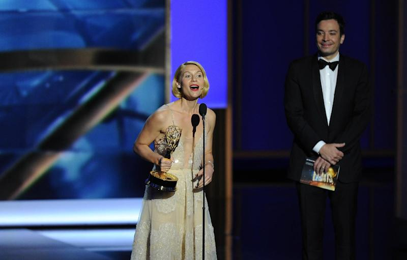 "Claire Danes accepts the award for outstanding lead actress in a drama series for her role on ""Homeland"" as presenter Jimmy Fallon looks on at right at the 65th Primetime Emmy Awards at Nokia Theatre on Sunday Sept. 22, 2013, in Los Angeles. (Photo by Chris Pizzello/Invision/AP)"
