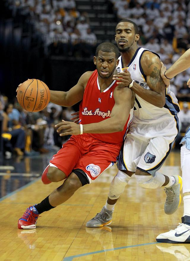 MEMPHIS, TN - APRIL 29: Chris Paul #3 of the Los Angeles Clippers dribbles the ball while defended by Mike Conley #11 of the Memphis Grizzlies the in Game One of the Western Conference Quarterfinals in the 2012 NBA Playoffs at FedExForum on April 29, 2012 in Memphis, Tennessee. NOTE TO USER: User expressly acknowledges and agrees that, by downloading and or using this photograph, User is consenting to the terms and conditions of the Getty Images License Agreement. (Photo by Andy Lyons/Getty Images)