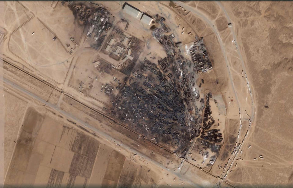 A satellite photo from Planet Labs Inc. shows the aftermath of a massive fire at Islam Qala border crossing in Afghanistan's Herat province on Tuesday, Feb. 16, 2021. The satellite photos analyzed Tuesday by The Associated Press show the devastation after a series of explosions and fires consumed hundreds of fuel tankers on the Afghan-Iranian border on Saturday, Feb. 13, 2021. (Planet Labs Inc. via AP)