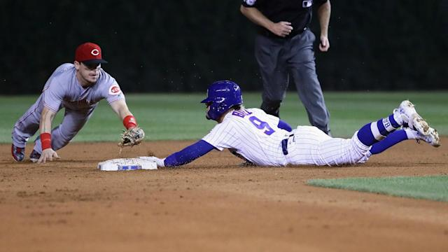 Javier Baez lifted the Chicago Cubs past the Cincinnati Reds, while the Atlanta Braves were put to the sword by the Colorado Rockies.