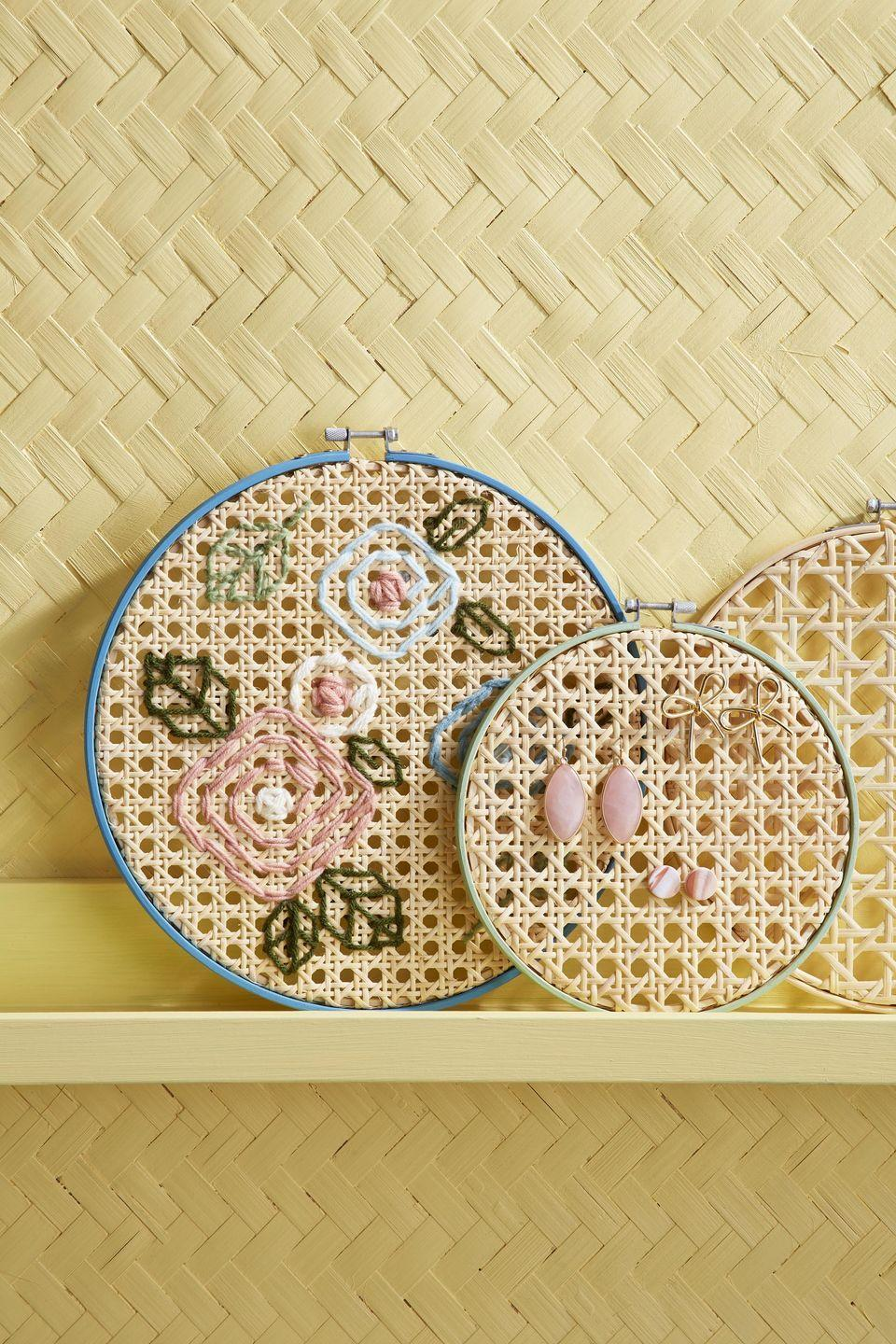 <p>Embroidery hoops filled with cane webbing can be turned into art work by stitching with yarn or simply used to hang ear rings. Either way, they are perfect for embellishing a wall or a shelf. <strong><br></strong></p><p><strong>To make:</strong> Separate rings of embroidery hoops. Cut pieces of caning that are just larger than the inside ring, then attach to the ring with hot- glue. Paint outer ring, if desired. Once dry, slip over inside ring and tighten. For artwork, thread yarn on a large-eyed needle, and stitch desired pattern. To use as a jewelry holder, simply hang or attach earrings through caning holes.</p>