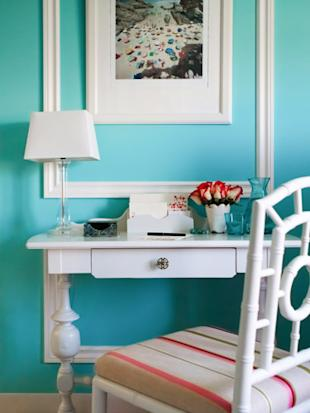 desk with blue wall