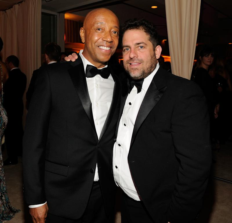 Russell Simmons (left) has been accused of forcing himself on a 17-year-old model and sexually assaulting her while Brett Ratner watched. (Kevin Mazur/VF13 via Getty Images)