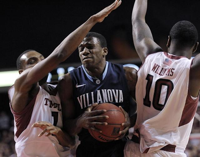 Villanova's Dylan Ennis (31) drives past Temple's Josh Brown (1) and Mark Williams (10) during the first half of an NCAA college basketball game on Saturday, Feb. 1, 2014, in Philadelphia. (AP Photo/Michael Perez)