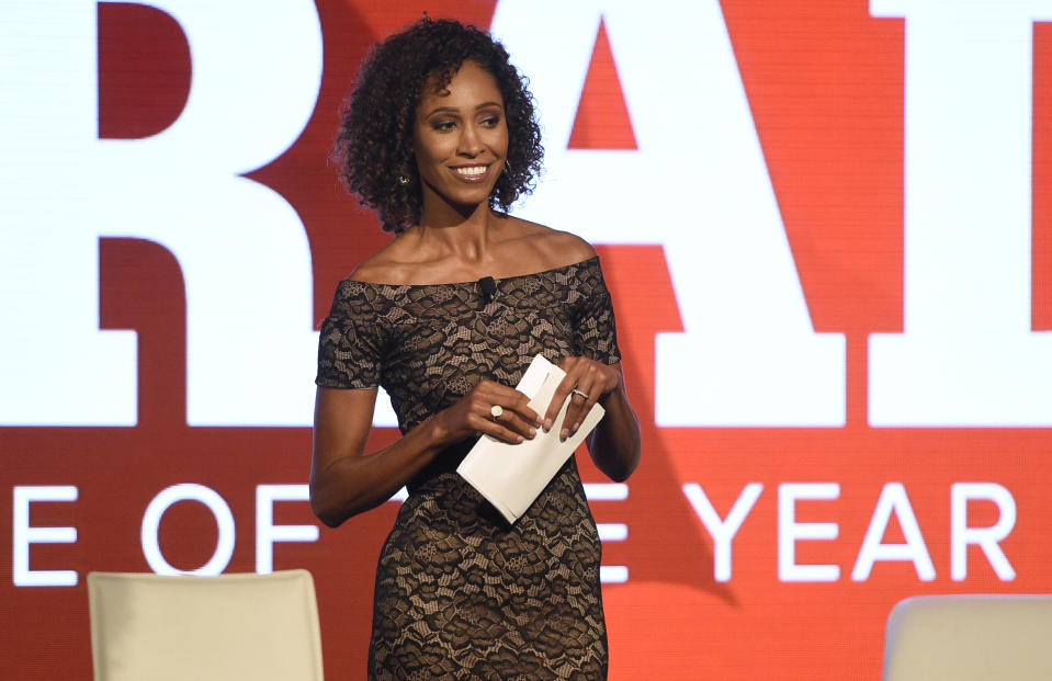 Sage Steele smiles onstage during an event.