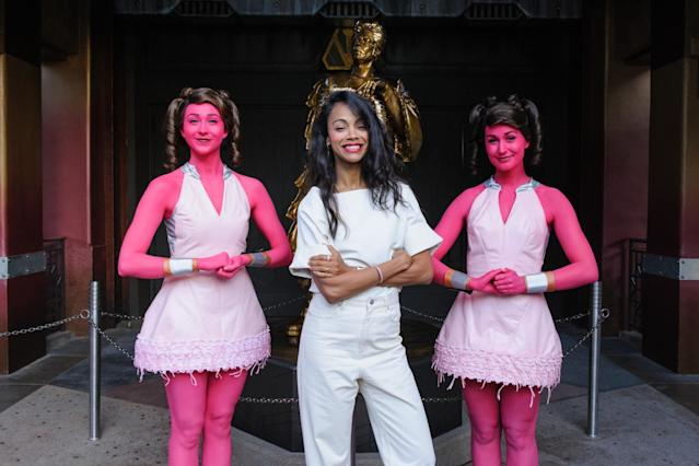 <p>The actress strikes a pose with two of the Collector's Krylorian assistants outside the Mission: Breakout! entrance. (Photo: Disneyland Resort) </p>