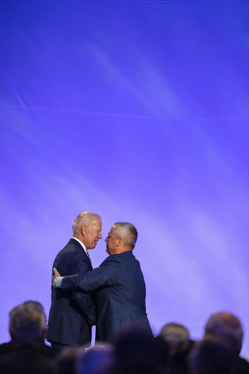 "WASHINGTON, DC - APRIL 05: Former Vice President Joe Biden and Brotherhood of Electrical Workers President Lonnie Stephenson greet on stage at the International Brotherhood of Electrical Workers Construction and Maintenance conference on April 05, 2019 in Washington, DC. Former Vice President Joe Biden on Friday called President Donald Trump a ""tragedy in two acts"" for the way he characterizes people and is consumed with personal grievances. (Photo by Tasos Katopodis/Getty Images) ORG XMIT: 775324810 ORIG FILE ID: 1140627678"