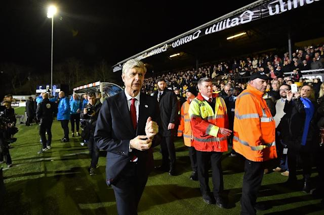 Arsenal's manager Arsene Wenger (C) arrives for the English FA Cup fifth round football match between Sutton United and Arsenal at the Borough Sports Ground, Gander Green Lane in south London on February 20, 2017 (AFP Photo/Glyn KIRK)