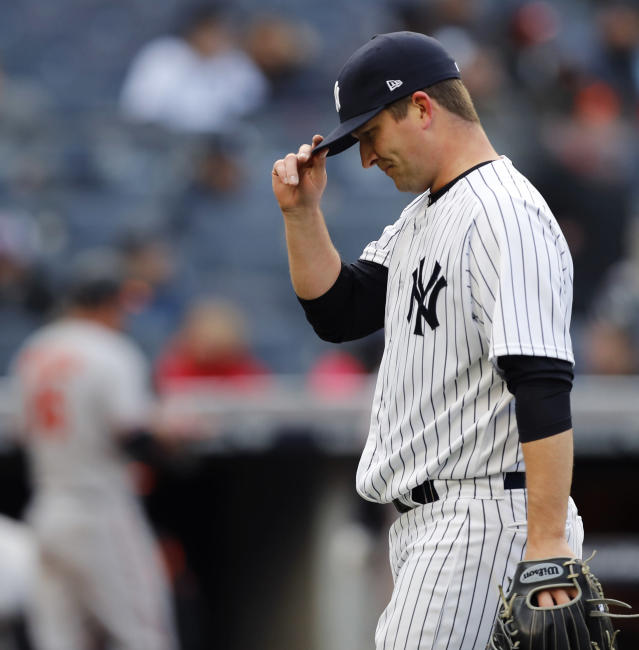 New York Yankees relief pitcher Adam Warren walks toward the dugout after allowing the go-ahead run during the eleventh inning of the Yankees 8-7 loss to the Baltimore Orioles in a baseball game in New York, Sunday, April 8, 2018. (AP Photo/Kathy Willens)