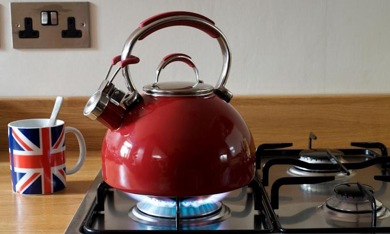 Red kettle on gas hob