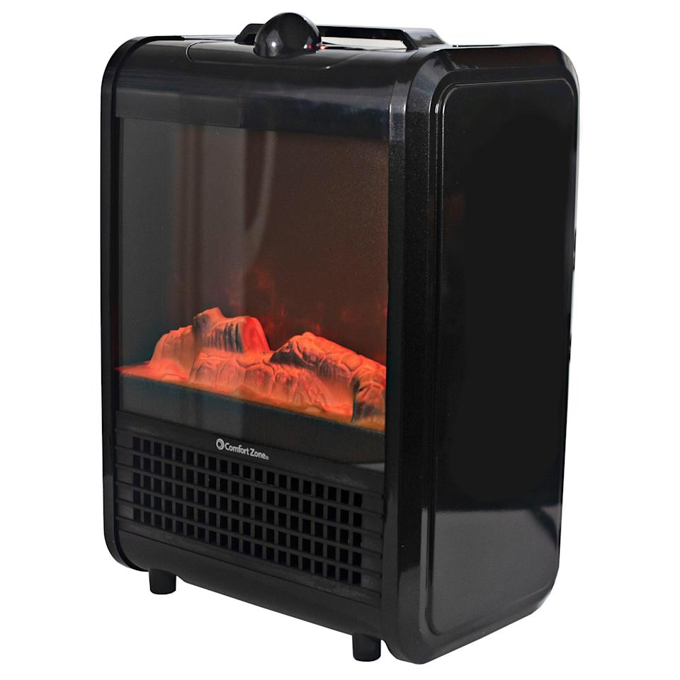 """<br><br><strong>Comfort Zone</strong> Comfort Zone Mini Portable Electric Fireplace Heater, $, available at <a href=""""https://go.skimresources.com/?id=30283X879131&url=https%3A%2F%2Ffave.co%2F37cdqBM"""" rel=""""nofollow noopener"""" target=""""_blank"""" data-ylk=""""slk:Walmart"""" class=""""link rapid-noclick-resp"""">Walmart</a>"""