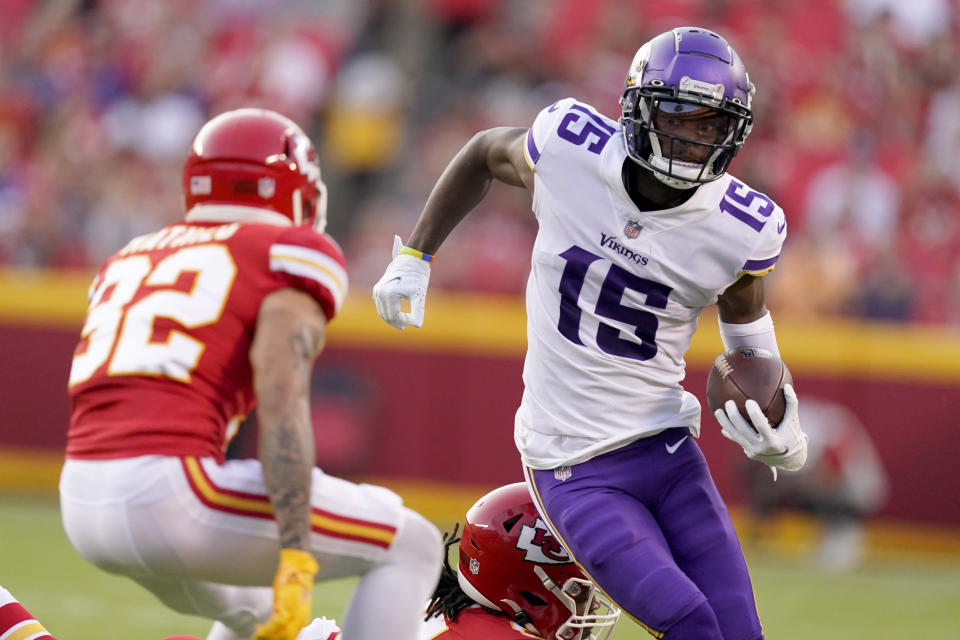 Minnesota Vikings wide receiver Ihmir Smith-Marsette (15) runs with the ball as Kansas City Chiefs safety Tyrann Mathieu (32) defends during the first half of an NFL football game Friday, Aug. 27, 2021, in Kansas City, Mo. (AP Photo/Charlie Riedel)