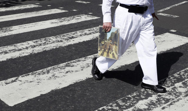 Fans recreate Beatles' Abbey Road cover shot 50 years on